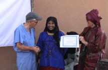 Achicha receives the certificate naming her Niger director of the mat